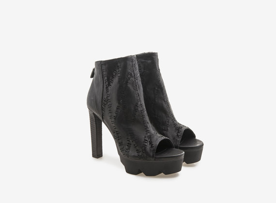 Engraved and washed leather peeptoe ankle boot