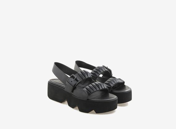 Sandalen mit großen Stollennieten - Schwarz