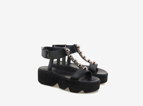 Black sandal with maxi studs and grip-fast sole