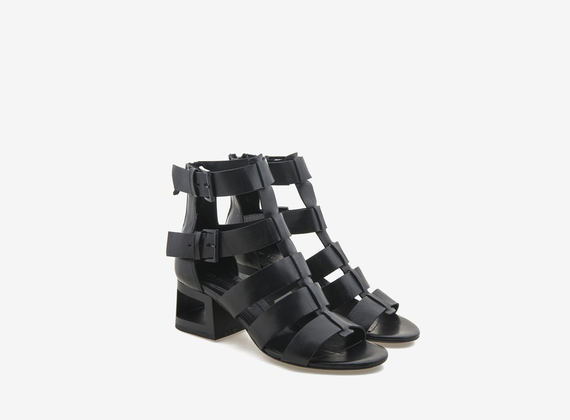 Two-buckle Tronchetto fascia ankle boot with perforated heel