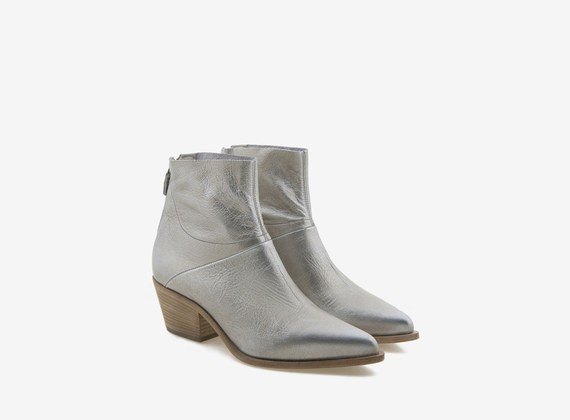 Laminated platinum leather ankle boot with zipper