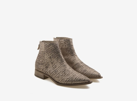 ankle boot with engraved copper-colour upper