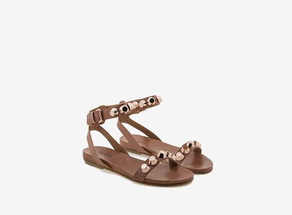 Leather sandal with maxi copper-colour studs