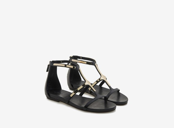 Sandal with metallic appliques