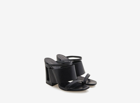 Black engraved leather sandal with perforated heel