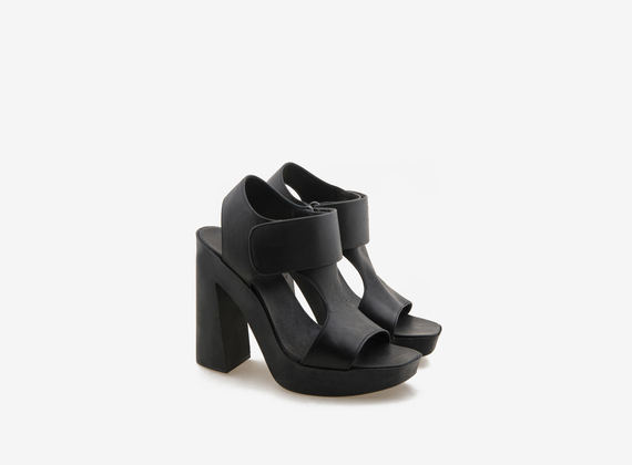 Black leather sandal with Velcro on rubber bottom