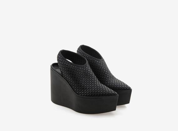 Sandales compensées en caoutchouc monochrome avec tressage élastique