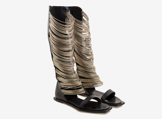 Gladiator boot in laser-treated leather and two-tone metallic rings