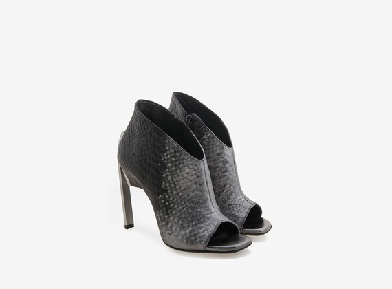 Open toe ankle boot with metallic veneer and steel heel
