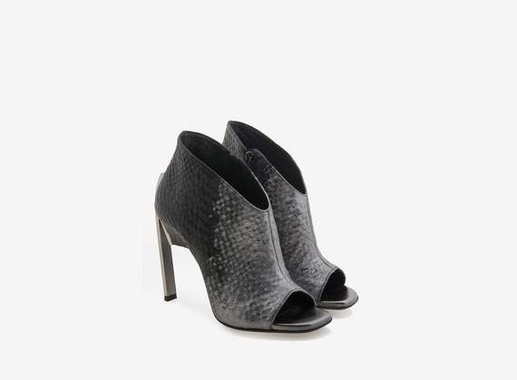 Open toe ankle boot with metallic veneer and steel heel