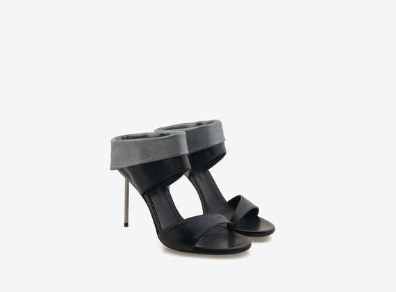Sandal with laminated turn-up and steel stiletto heel