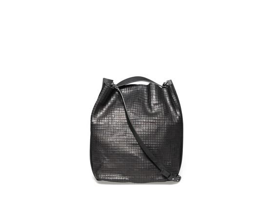 Bucket bag with a rigid strap