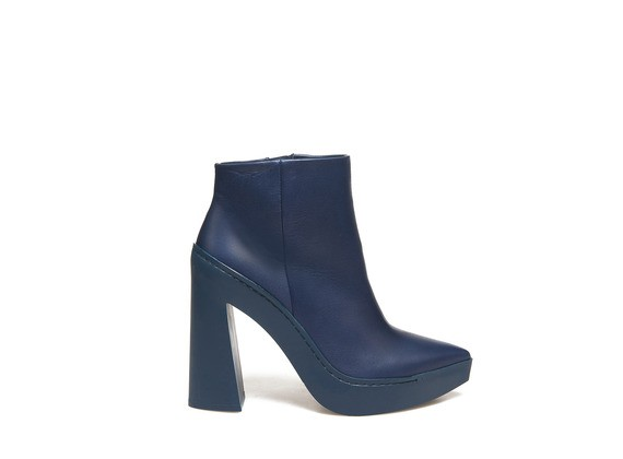 High-heeled blue ankle boots with rubber flared heel