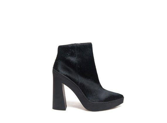 Ankle boot with pony skin effect and flared rubber heel