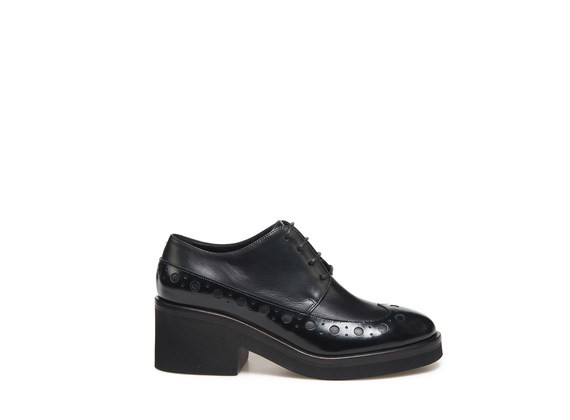 Black derby shoe with perforated shaft
