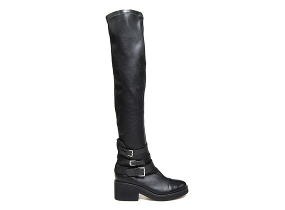 Elasticated boot with multiple buckles and a rubber sole