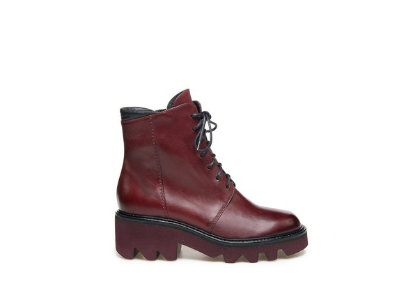 Burgundy military boots with matching rubber chunky soles