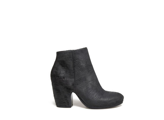Carved leather ankle boots with shell-shaped heel