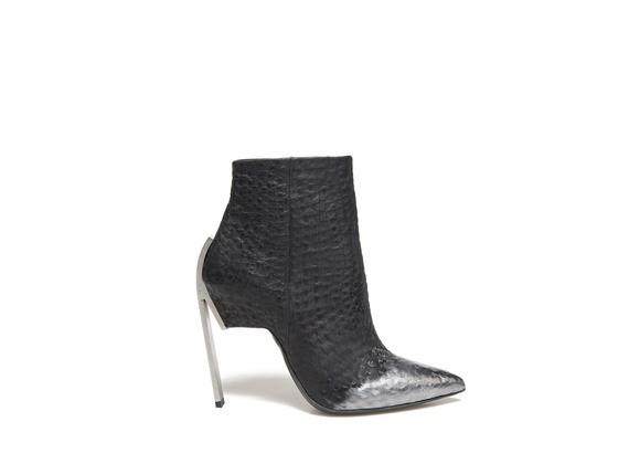 Ankle boot with metallic coating and steel heel