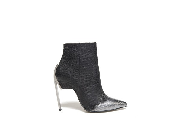 Ankle boot with metallic coating and steel heel