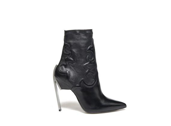 Mi-bottes stretch avec broderies texanes et talons acier