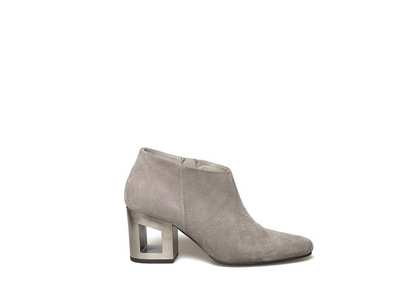 Grey suede ankle boot with perforated heel
