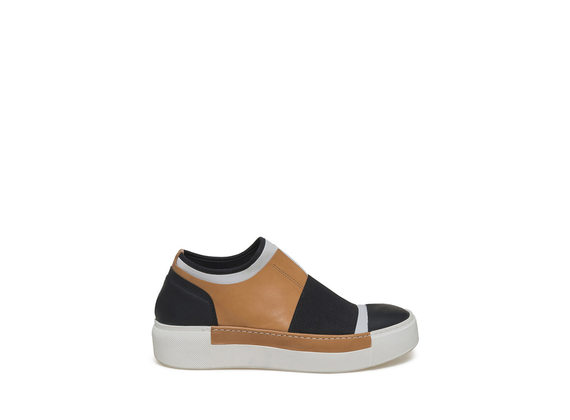 White neoprene slip-on with cowhide patched piece