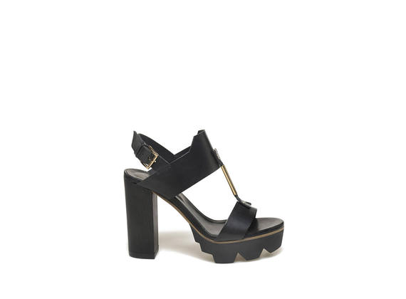 Sandal with heavy tread and metallic accessory