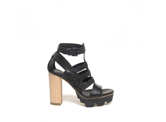 Caged sandal with wooden heel