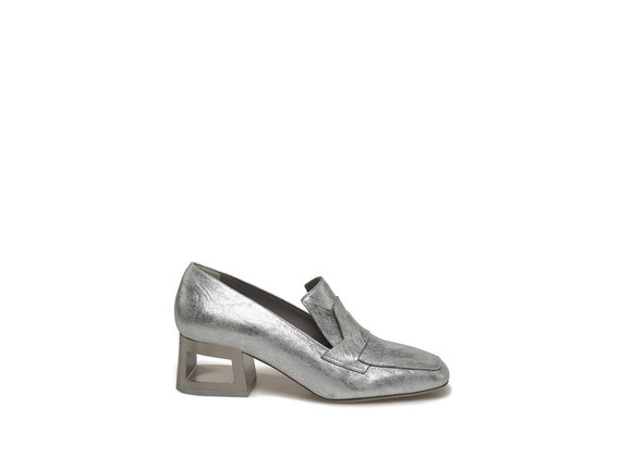 Silver loafer with perforated heel