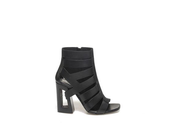 Peep-toe asymmetrical low boot on perforated heel