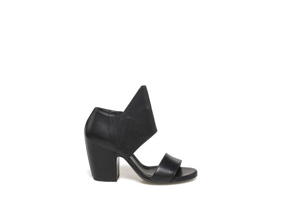 Sandal with maxi flap and shell-shaped heel