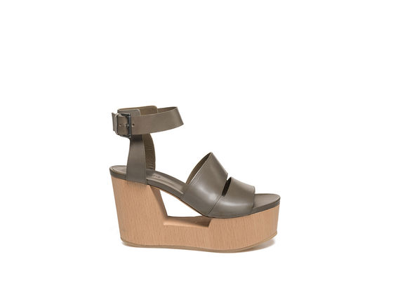 Military green sandal on perforated wooden wedge