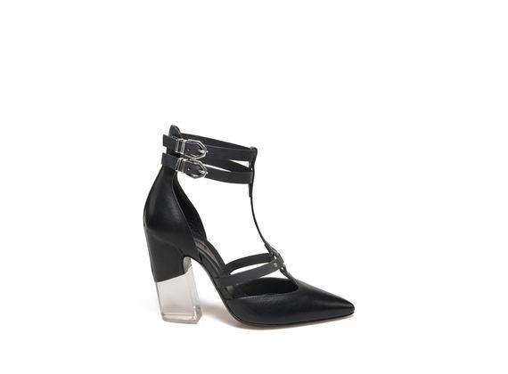 Decollété with straps and plexi heel