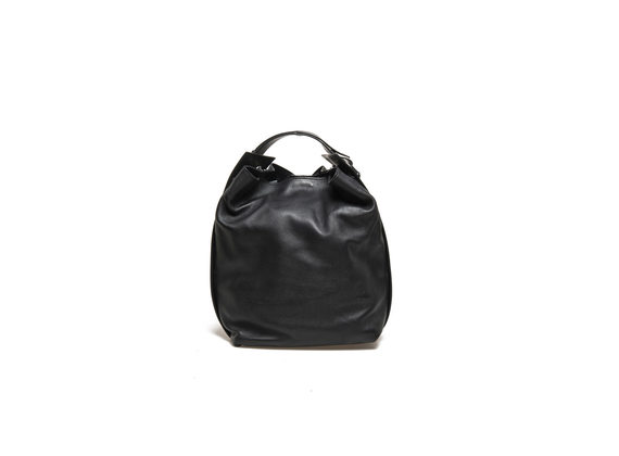 Black bucket bag with piercing