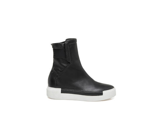 Stretch heeled ankle boots with contrast sole