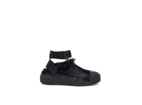 Pantofola nera in lapin