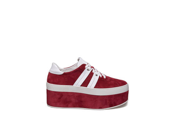 Lace up shoe with bands on red suede platform
