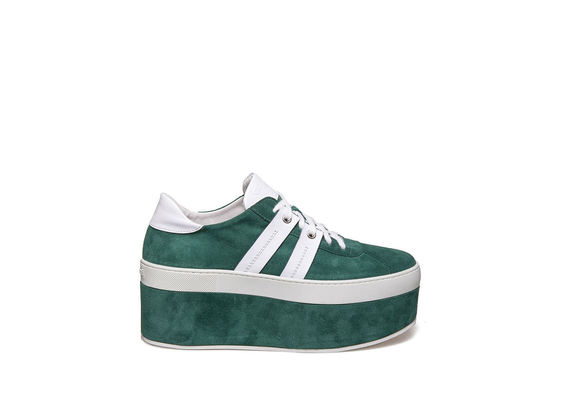 Lace up shoe with bands on green suede platform