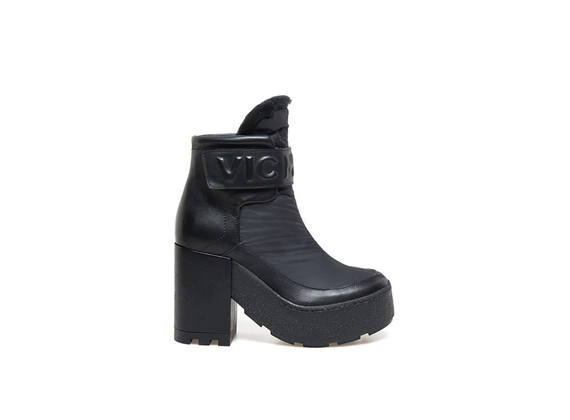 Technical black booties and embossed logo
