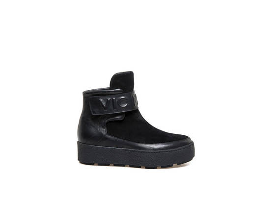 Velcro ankle boots and embossed logo