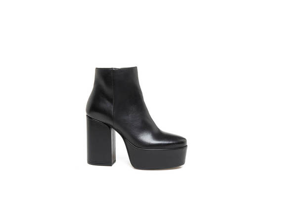 Black leather ankle boots with maxi plateau and heel