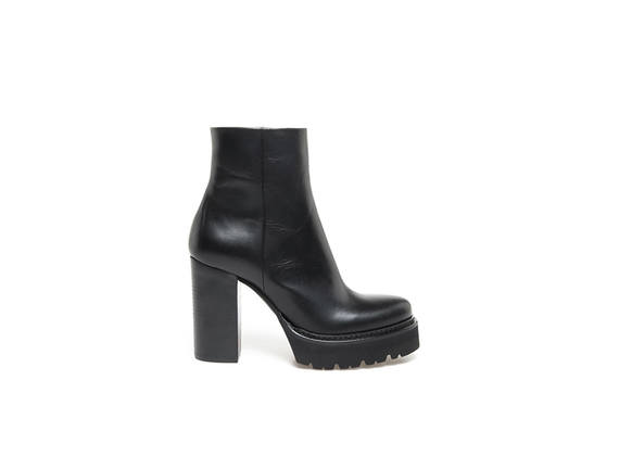 Black leather heeled ankle boots with Panama sole