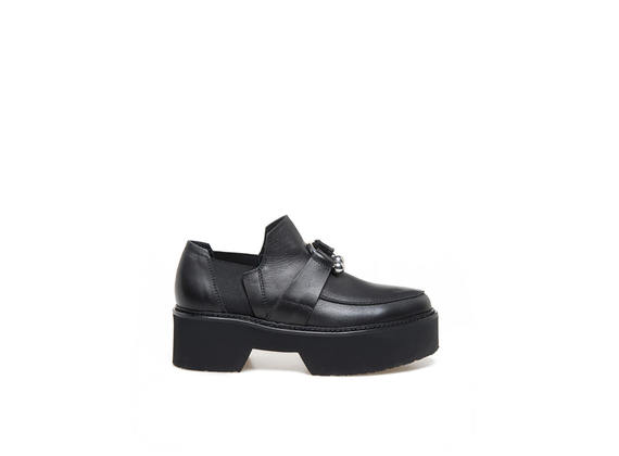 Moccasins in black leather with piercing and maxi rubber bottom