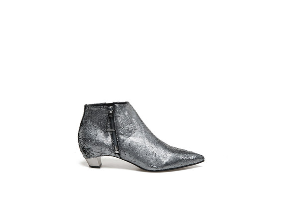 Carved metallic leather ankle boots with side zip and metal heel