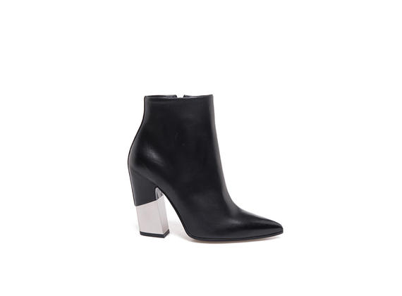 Pointed toe black ankle boots with partially-covered metal shell-shaped heel