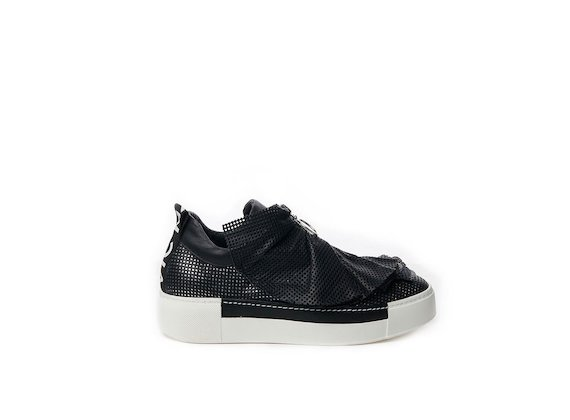 Perforated leather slip-on with black ruffles