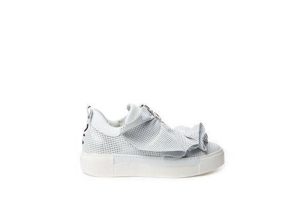 Perforated leather slip-on with white ruffles