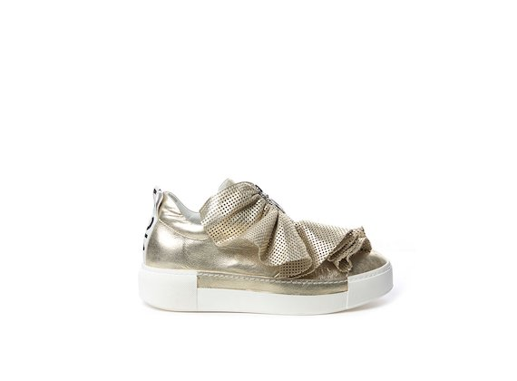 Platinum laminated leather slip-on with perforated ruffles