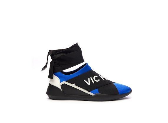 Slip-on bluette con elastico e nastro alla caviglia